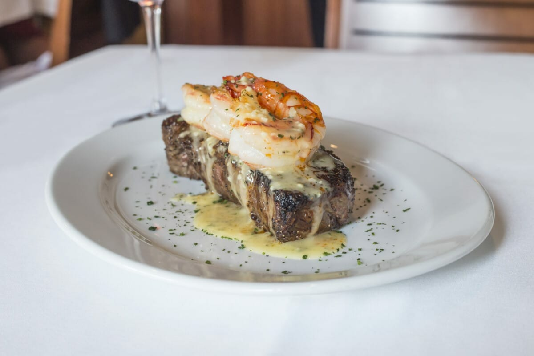 Ocean Prime NY Strip Steak with Garlic Shrimp Scampi. Photo courtesy Ocean Prime Phoenix