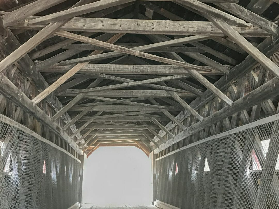timbers in covered bridge in vermont